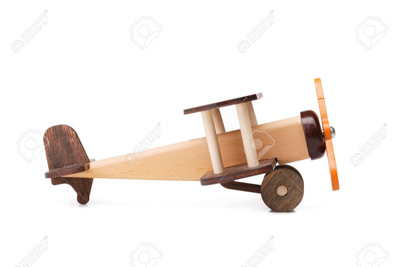 Una Imagen De Primer Plano De Un Avion De Juguete De Madera Marron