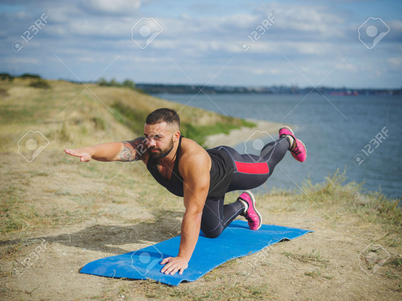 Athletic Strong Man Practicing Difficult Yoga Pose Outdoors Young Male