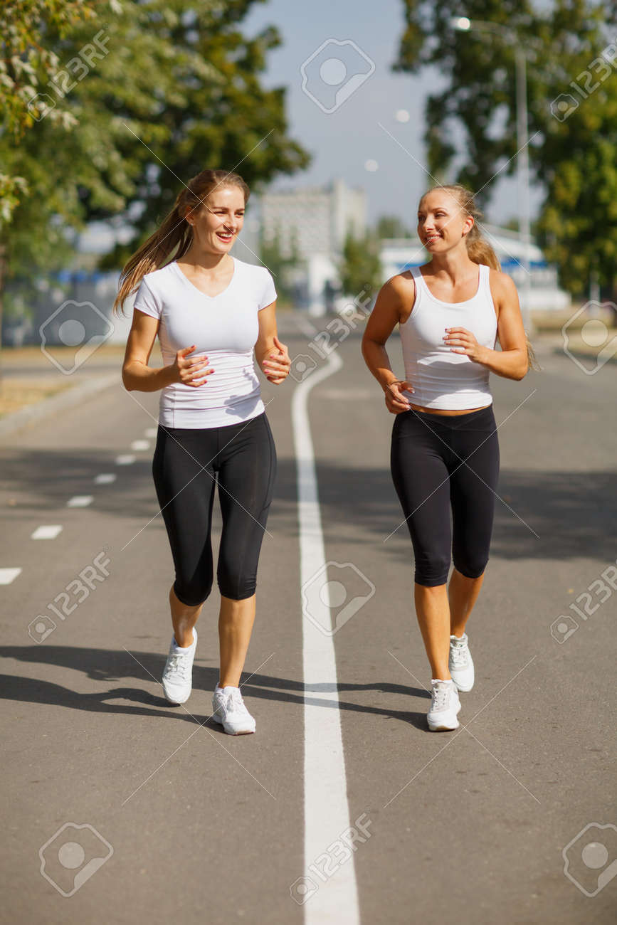 Gorgeous Girls Running On The Blurred Background. Sporty Youth... Stock  Photo, Picture And Royalty Free Image. Image 87352613.