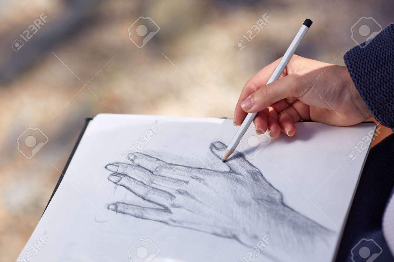 A Girl Sitting On A Bench Made A Beautiful Hand Drawing With