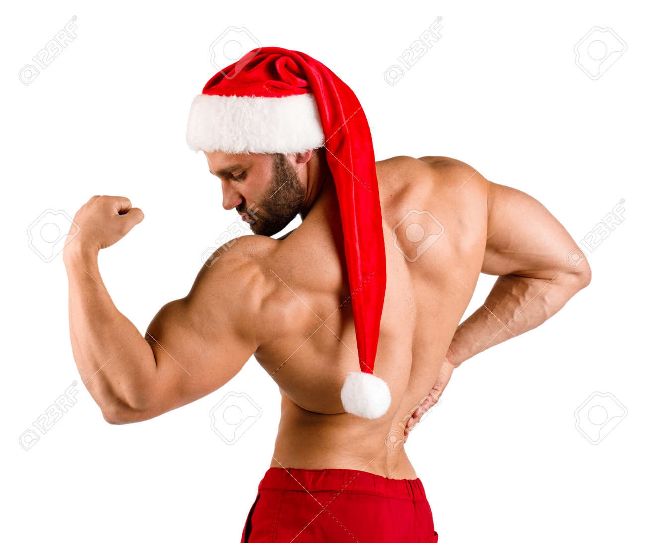 Bearded man in Santa costume flexing muscles isolated on a white background. Winter sports concept  sc 1 st  123RF.com & Bearded Man In Santa Costume Flexing Muscles Isolated On A White ...