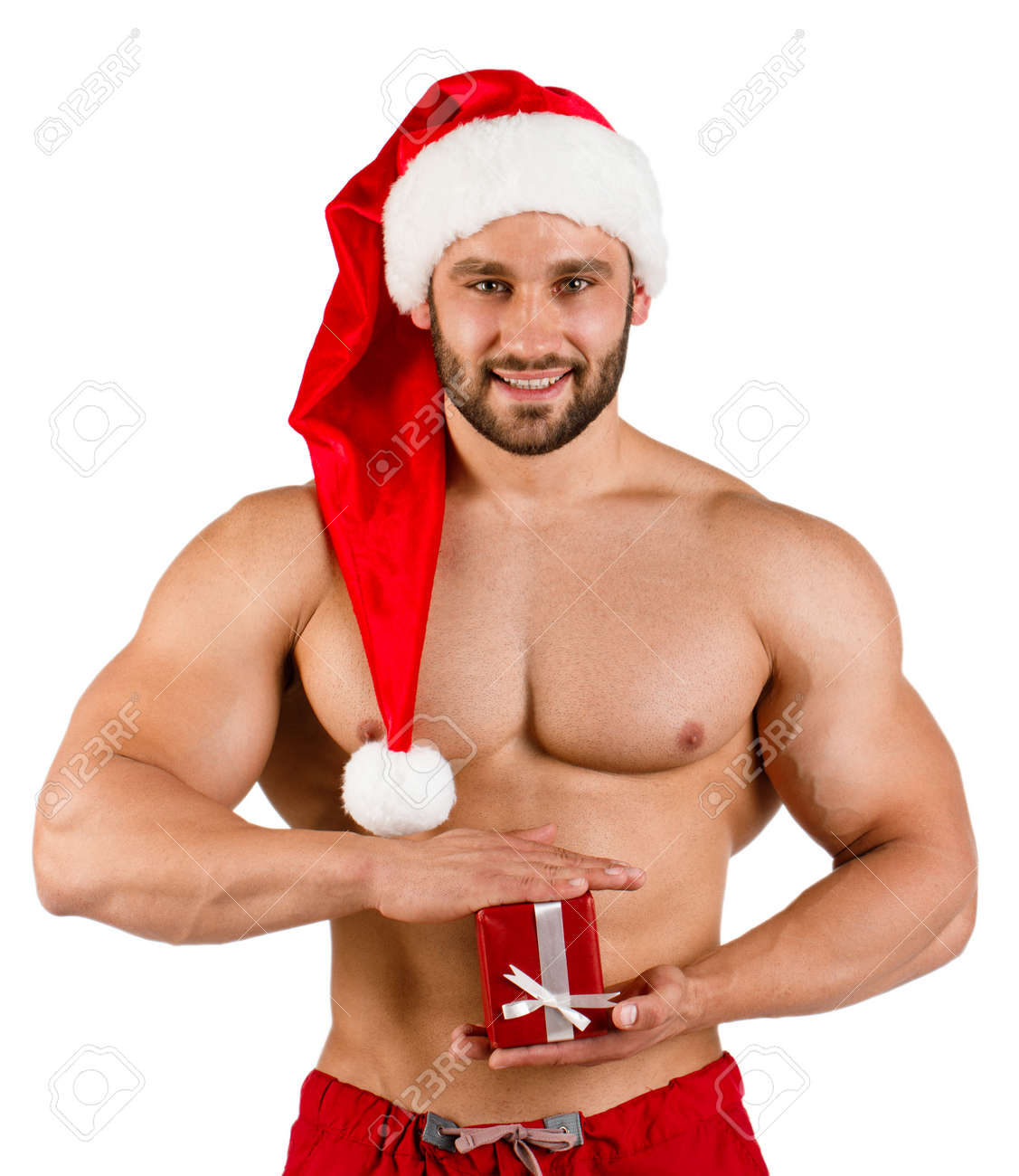 Strong Smiling Man Dressed As Santa Claus With Red Hat And Small