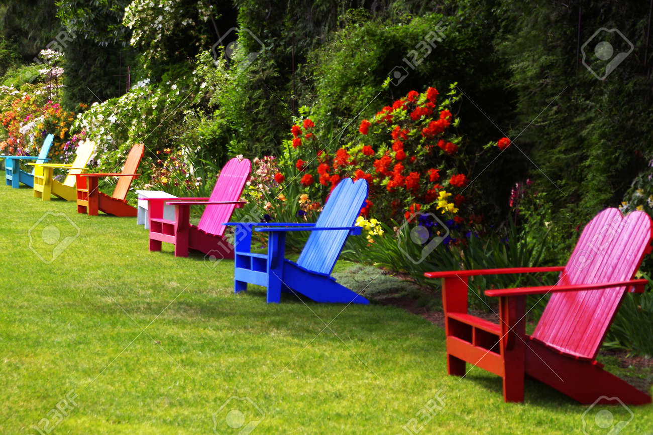 Colorful adirondack chairs - Colorful Adirondack Chairs In Display Garden Stock Photo 13759366