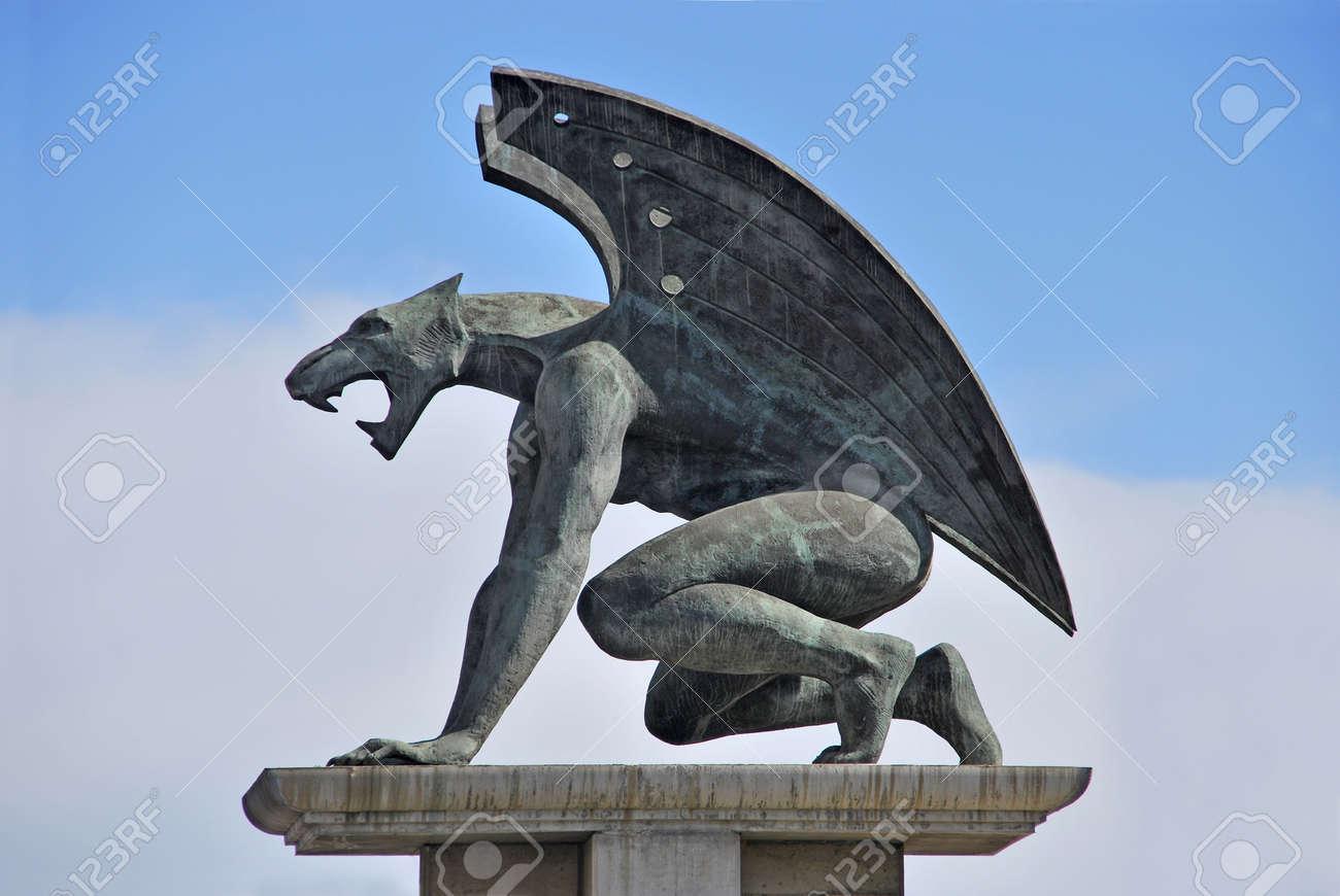 One of the four guardian gargoyles over Pont del Regne bridge of the kingdom Valencia - 13401557