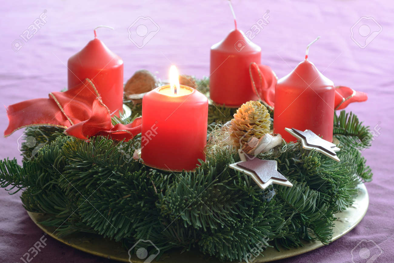 First candle on advent wreath burns as a symbol of preparation first candle on advent wreath burns as a symbol of preparation for christmas stock photo buycottarizona Image collections