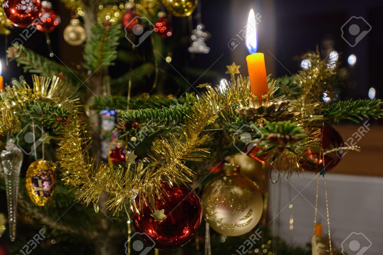 Burning Christmas Tree.Spirited Christmas Tree And Burning Christmas Tree Candle Close Up