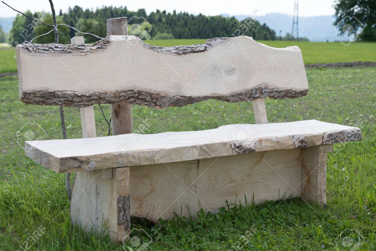 Rustic garden bench made of solid hardwood