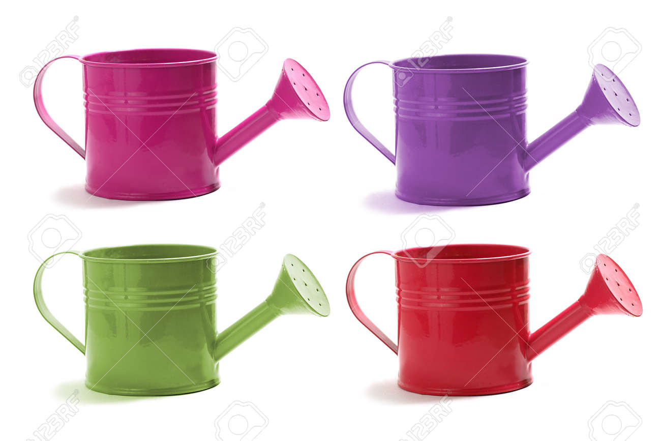 A set of four watering cans on white in red, green,violet, and pink Stock Photo - 13199615