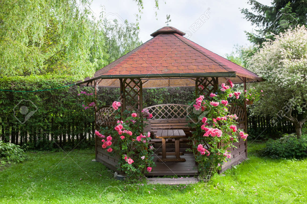 Outdoor Wooden Gazebo With Roses And Summer Landscape Background Stock Photo 60075832