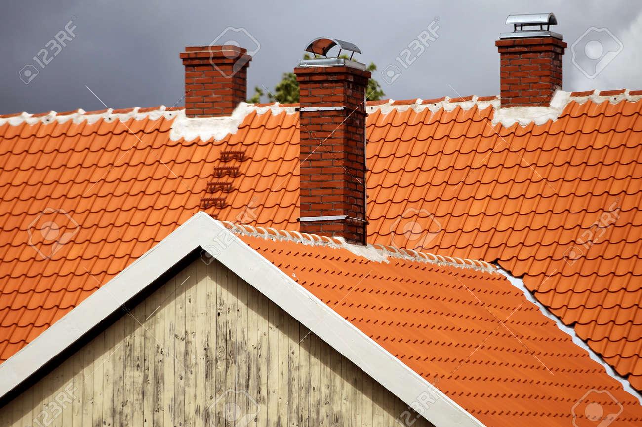 Red tiled roofs of Kuldiga old town buildings. Latvia - 157028388