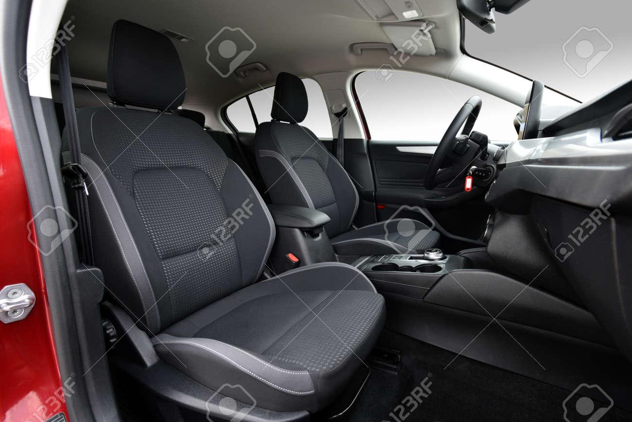 Front seats of a modern passenger car - 125392347