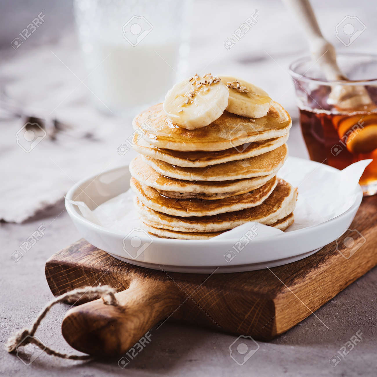 Fresh pancakes with maple syrup and bananas - 133864036