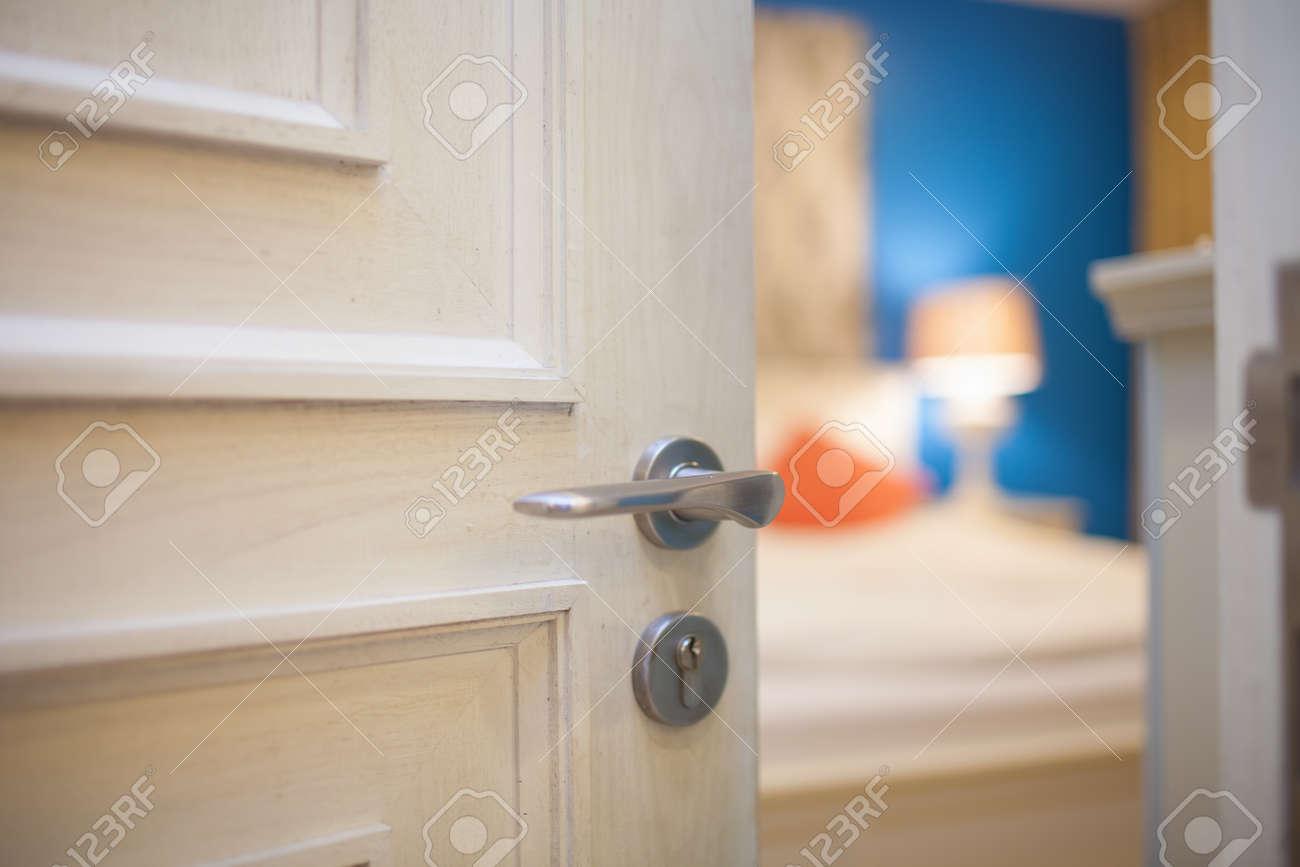 Merveilleux Half Open Door Of A Bedroom Stock Photo   35105786