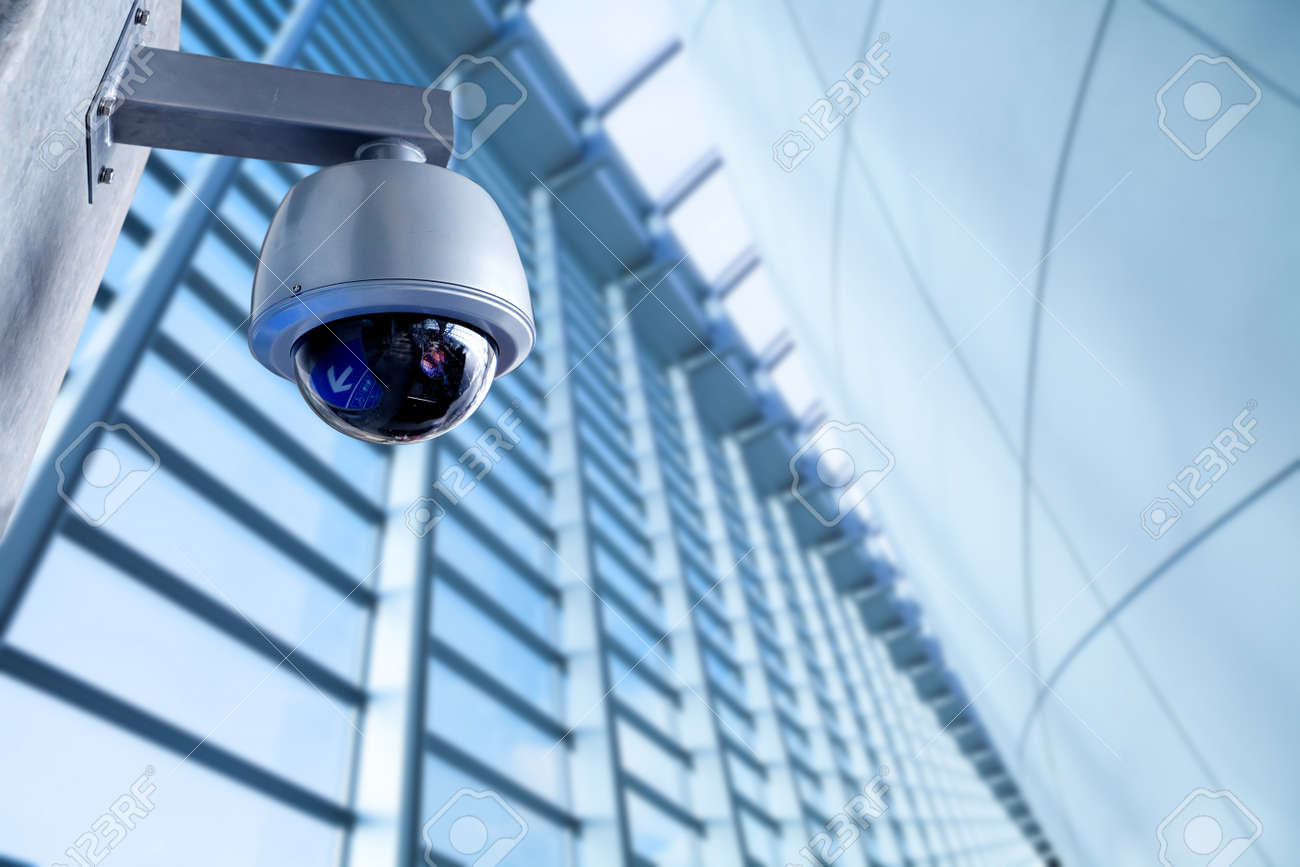 Security CCTV camera in office building - 51697332