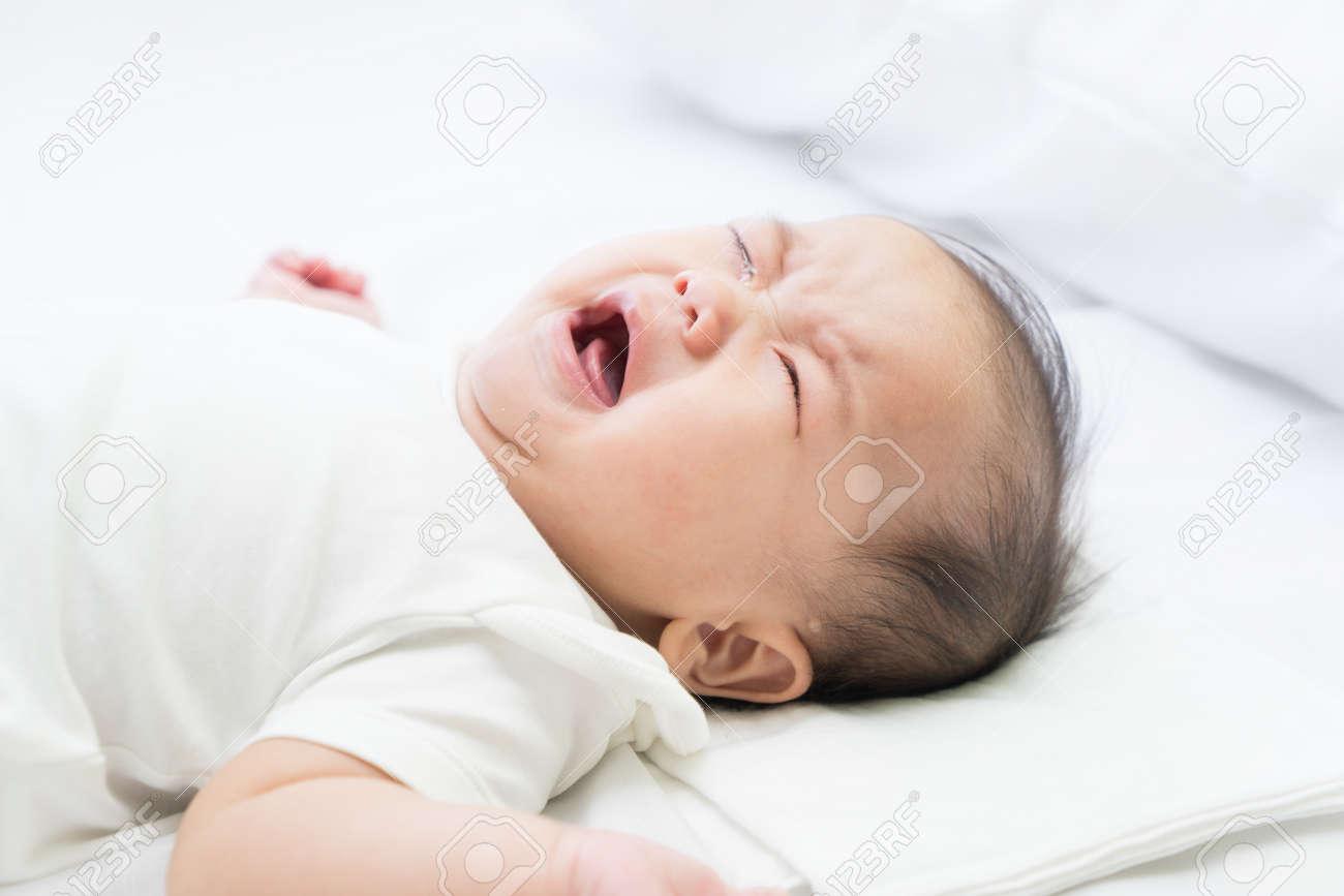 Newborn Asian baby crying - 57206221