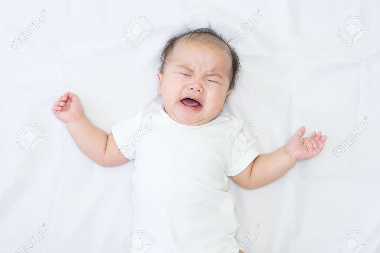Newborn Asian baby crying - 57206830
