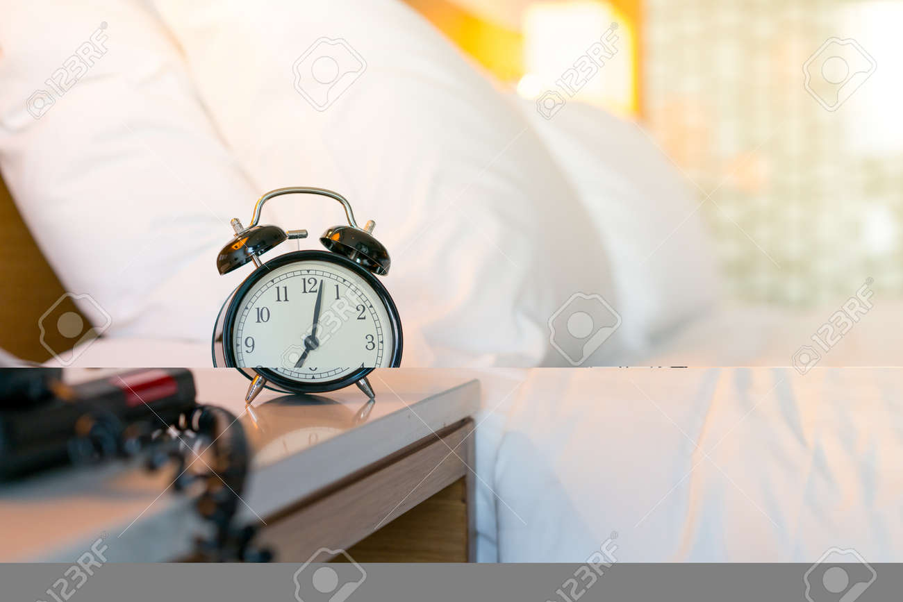 Metal Alarm clock on white bedroom