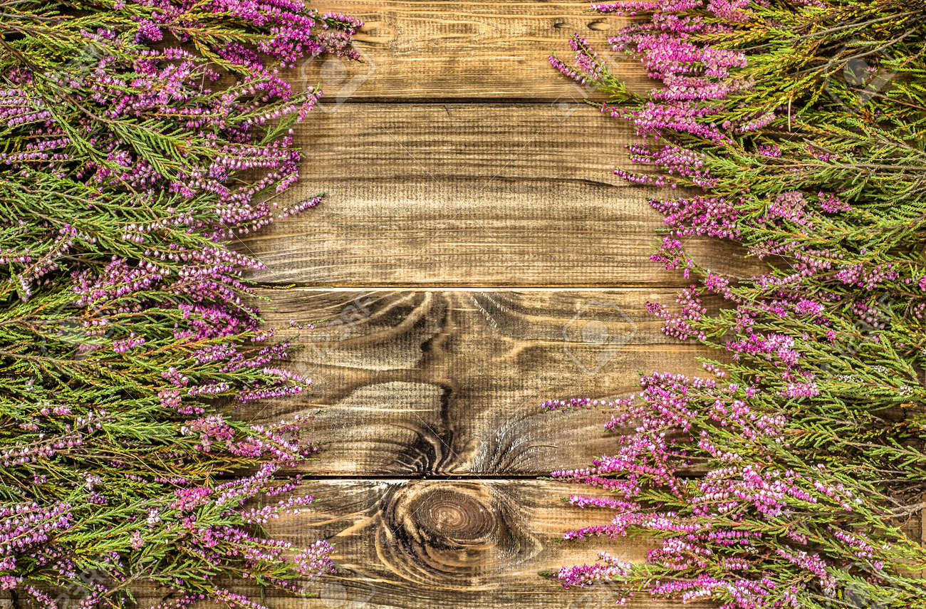 Floral Frame With Heather On Rustic Wood Flowers Background