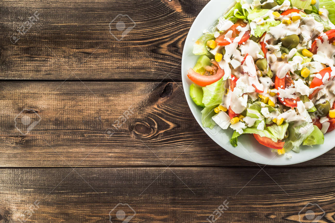 Vegetarian Salads Top View Greek Salad With Feta Cheese Tomato Stock Photo Picture And Royalty Free Image Image 68099787