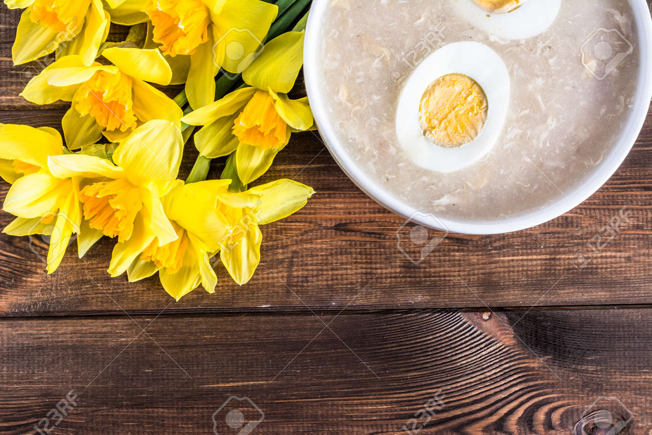Traditional easter soup white borscht with eggs and daffodils stock photo traditional easter soup white borscht with eggs and daffodils easter greeting card m4hsunfo
