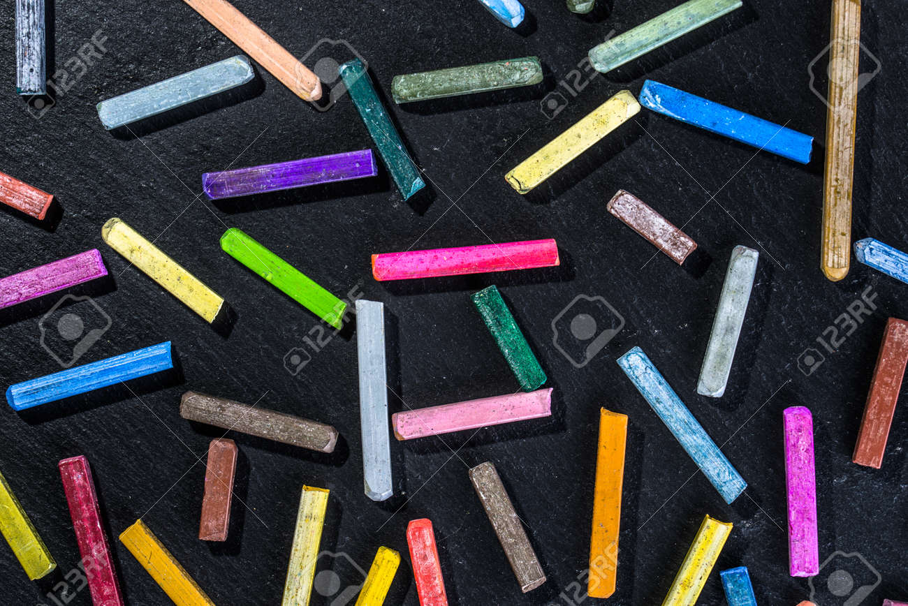 Colorful Wallpaper Pattern With Colored Chalks On Black Background