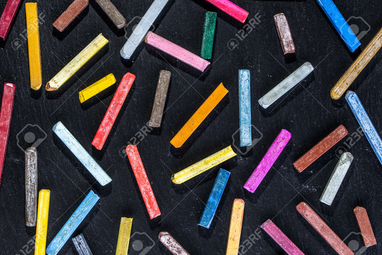 Colorful Wallpaper With Chalks Pattern On Black Background Of