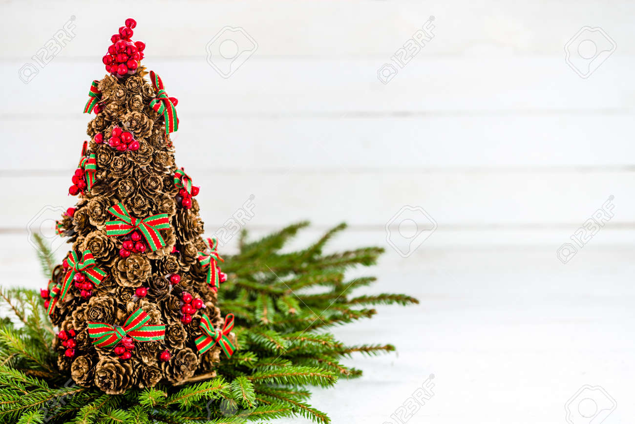 Pine Cone Christmas Tree Background With Red Holly And Fir On Stock Photo Picture And Royalty Free Image Image 86948038