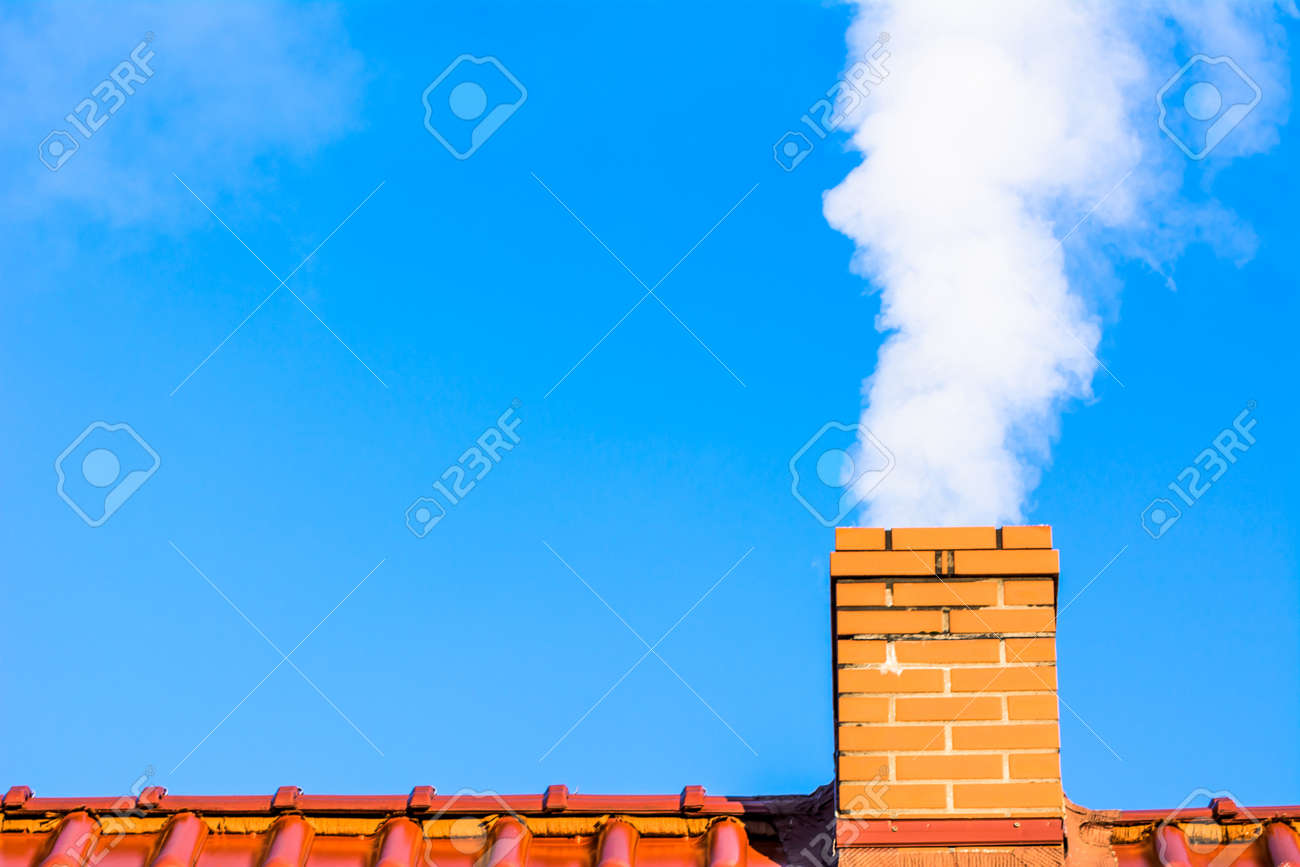 Modern house roof with chimney smoke, air pollution and smog in winter, ecological problems - 90793196