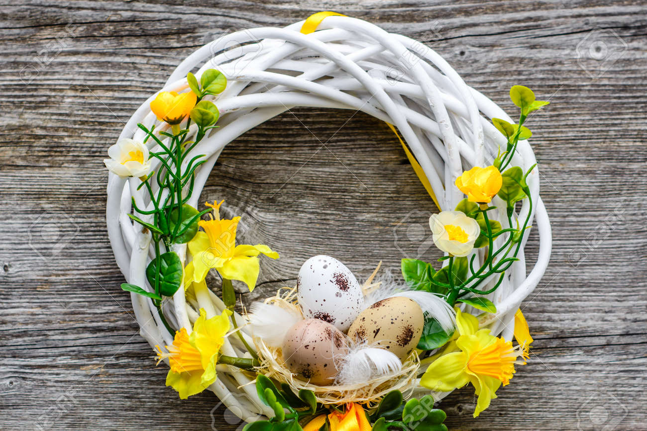 Easter Background With Spring Easter Eggs And Flowers Wreath Stock Photo Picture And Royalty Free Image Image 94484640