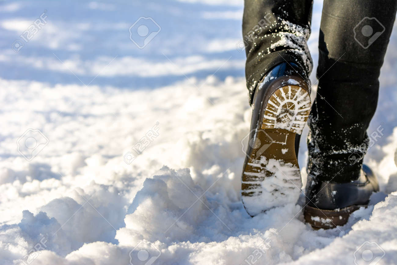 Woman Walking In Snow Boots And Jeans