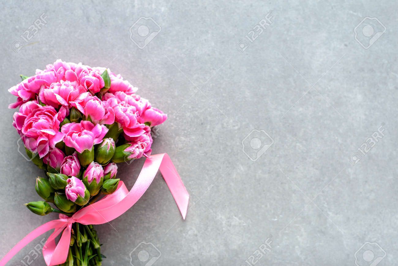 Pink Bouquet Of Wedding Flowers On Grey Background Stock Photo Picture And Royalty Free Image Image 97465660