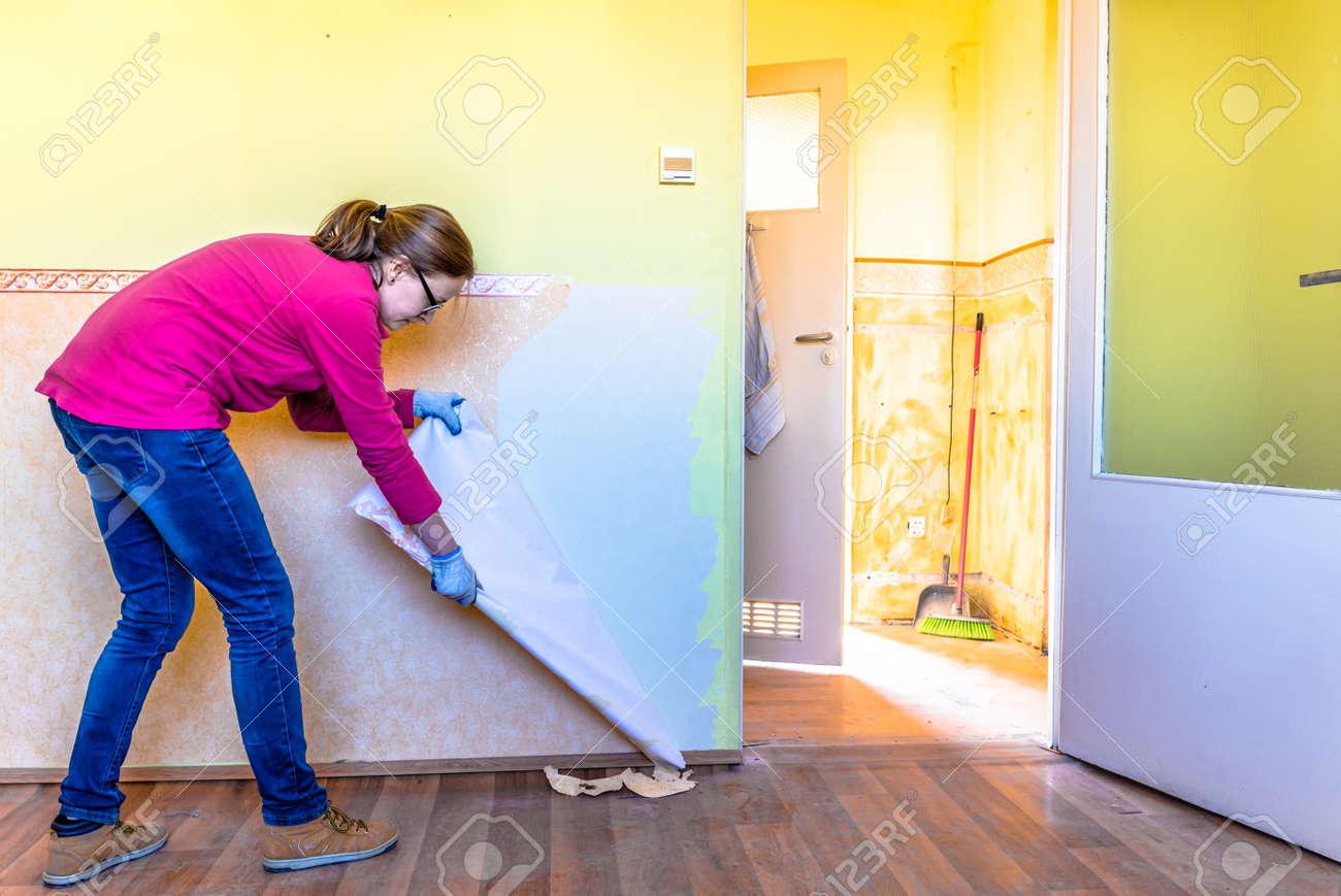 Home Renovation Room Wall Repairing Woman Removing Old Wallpaper Stock Photo