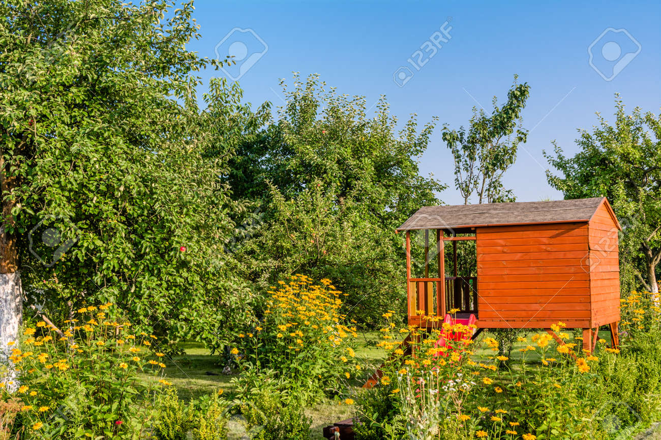 Summer Kids House In Green Garden With Flowers Playhouse Cottage