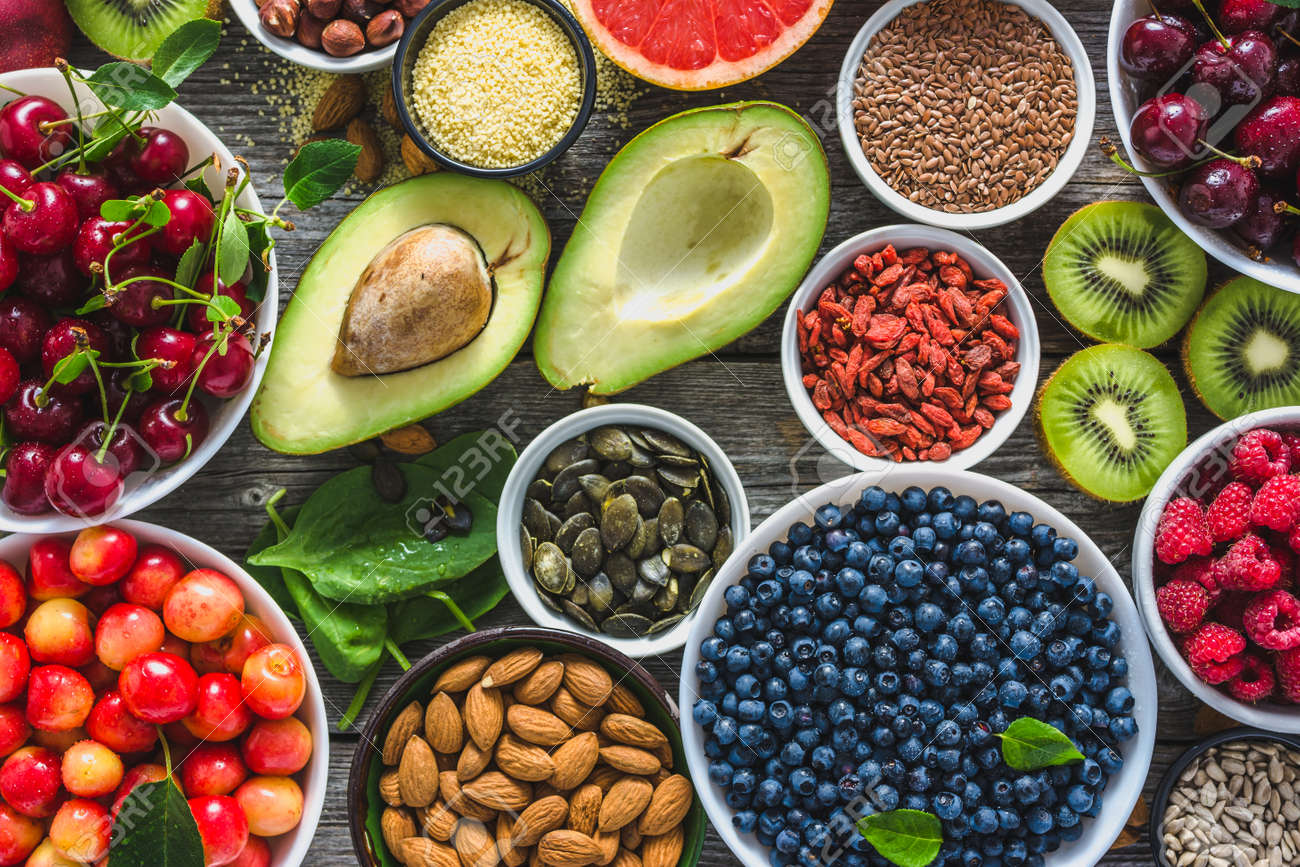 Healthy food selection, nuts, fruits and assortment of superfoods, top view - 112054261