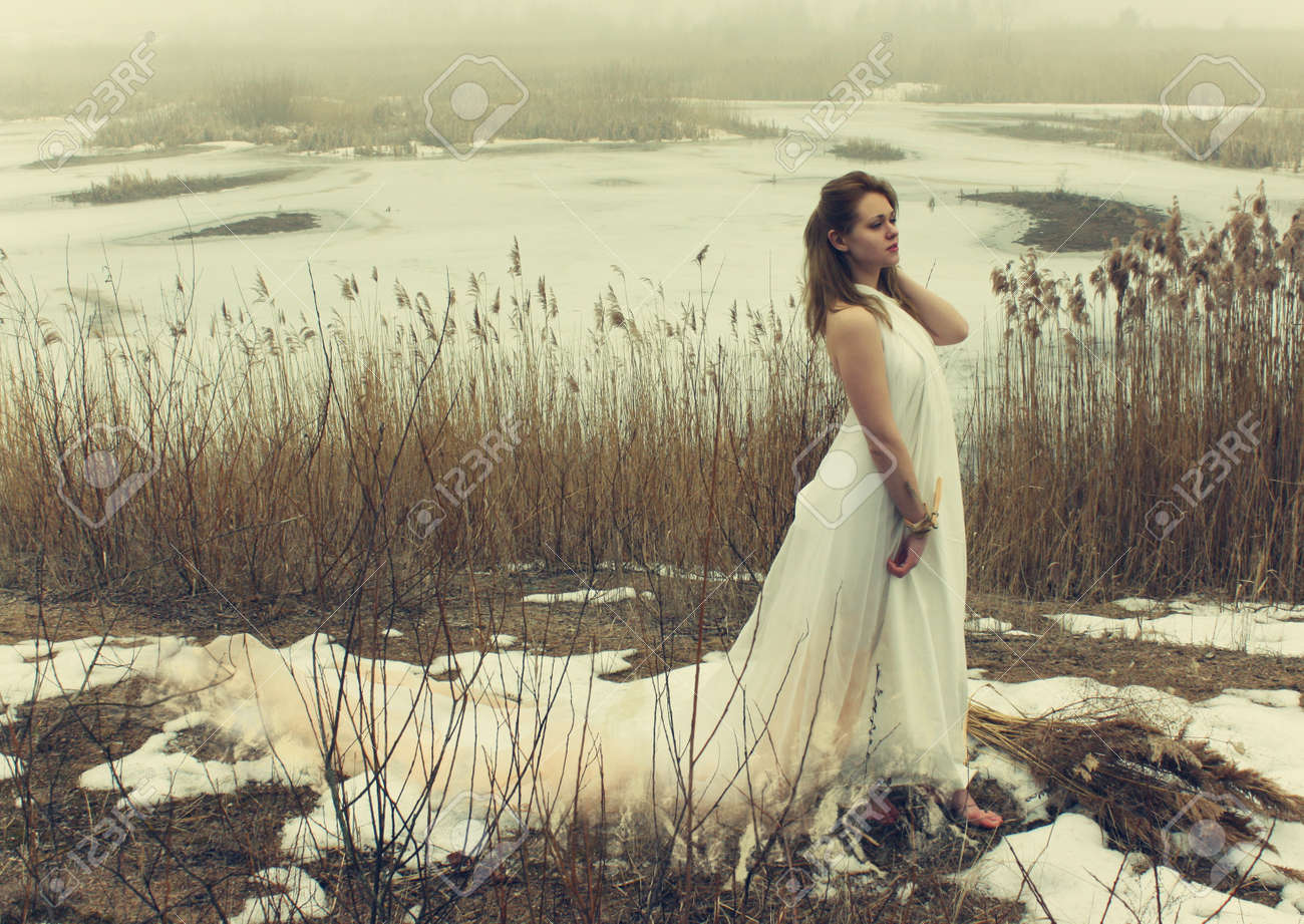woman in white dress in the winter on the rushy lake Stock Photo - 12985255