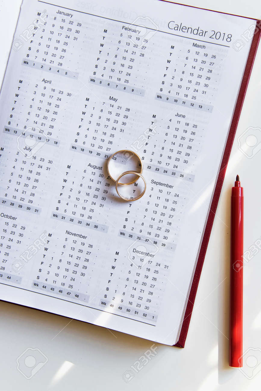 planning a wedding in 2018 calendar of 2018 two wedding rings and a pen