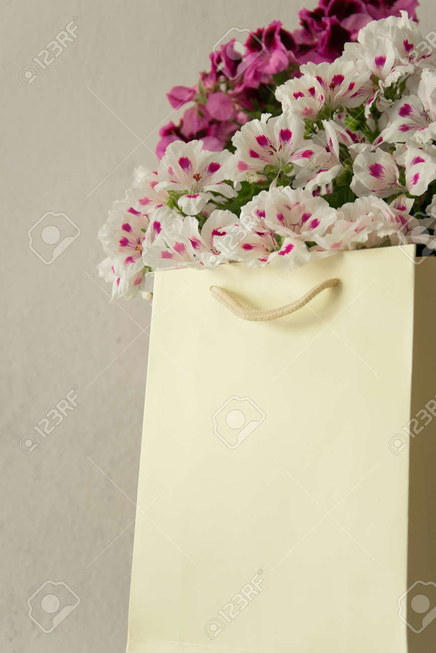 Beautiful Fresh Flowers In The Paper Bag Decoration Gift Concept