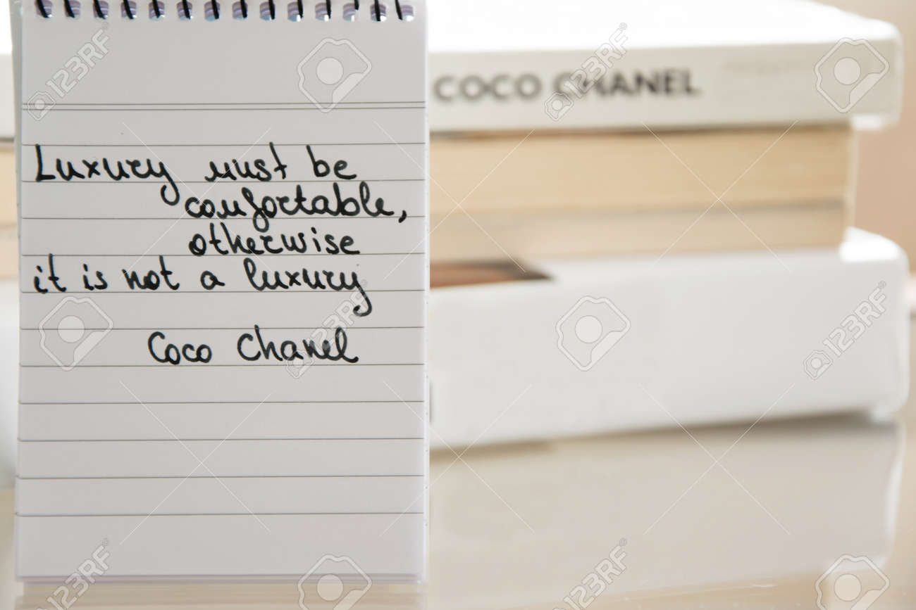 Coco Chanel quotes written on a block note, inspiration phrase..