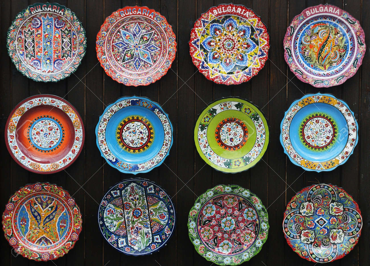 Colorful souvenirs hand painted ceramic plates on the wall in the bulgarian market Stock Photo - & Colorful Souvenirs Hand Painted Ceramic Plates On The Wall In ...