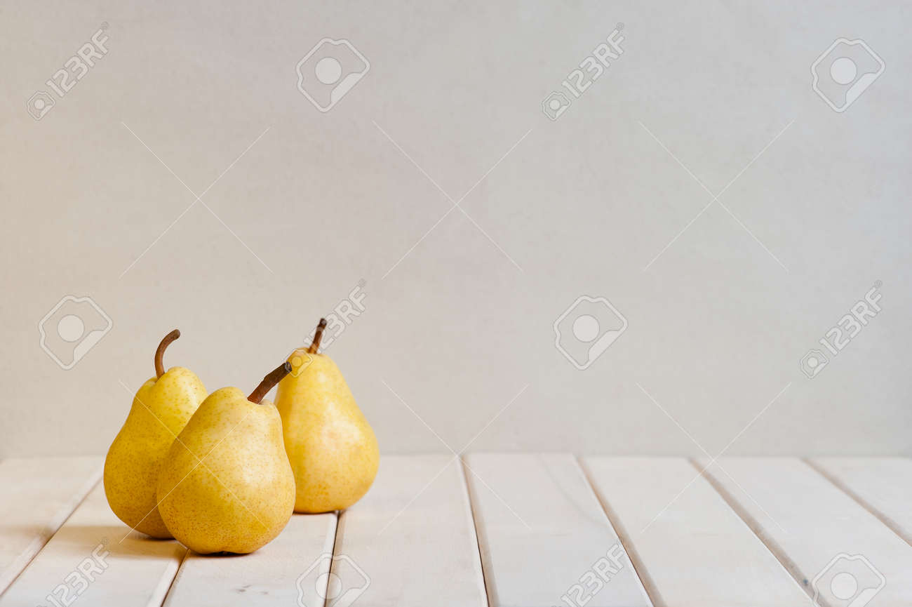 Yellow pears on the white table - 38744208