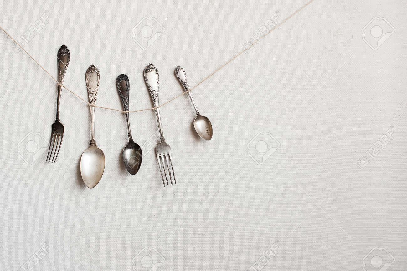 Silverware hangs on the string - 38946039
