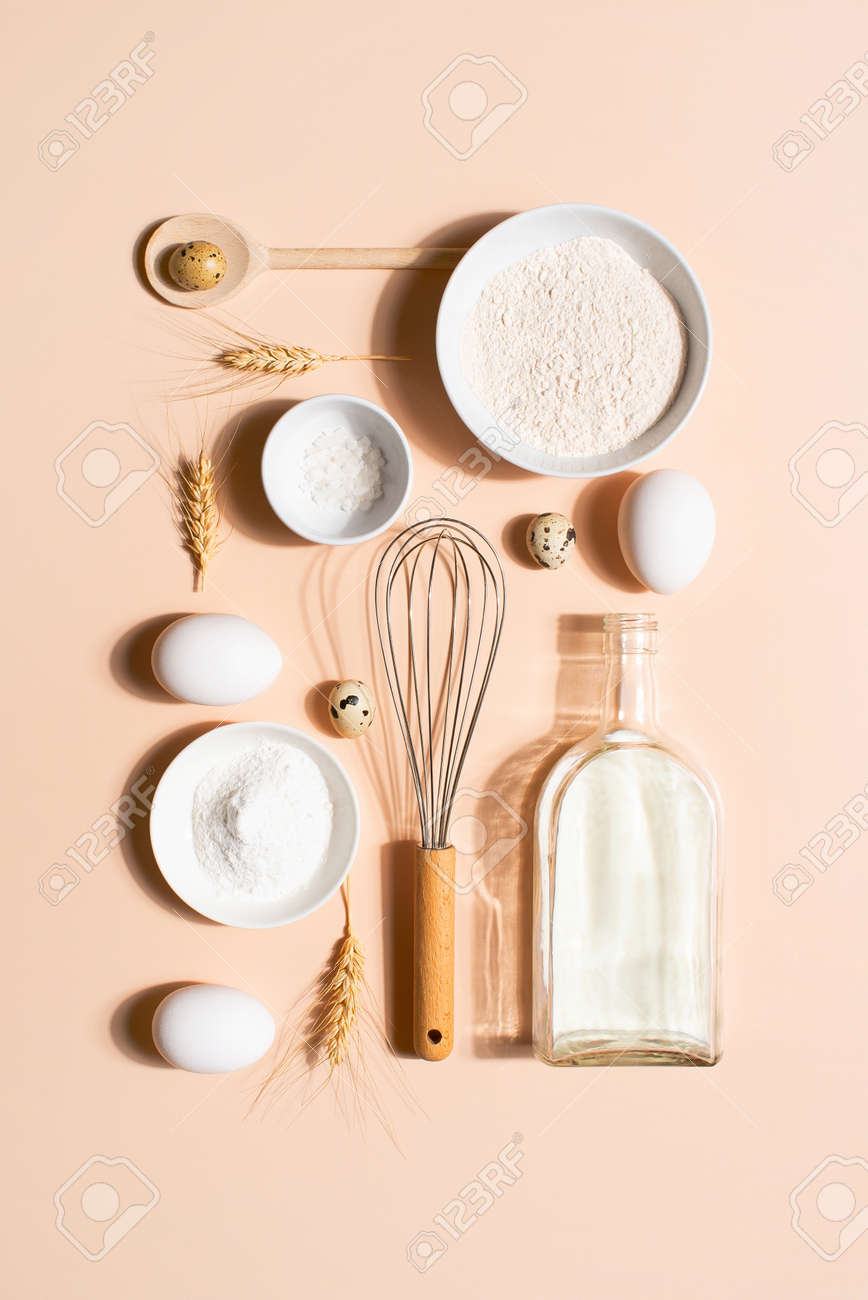 Raw ingredients for pancakes on the beige table, top view - 168918306