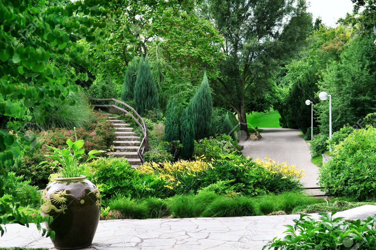 Park with beautiful avenues, flowerbeds and shrubs Stock Photo - 14736120