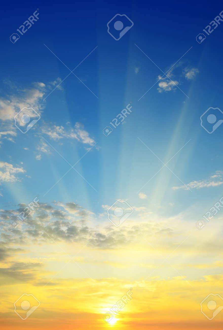 the sun rays illuminate the sky above the horizon - 14809103