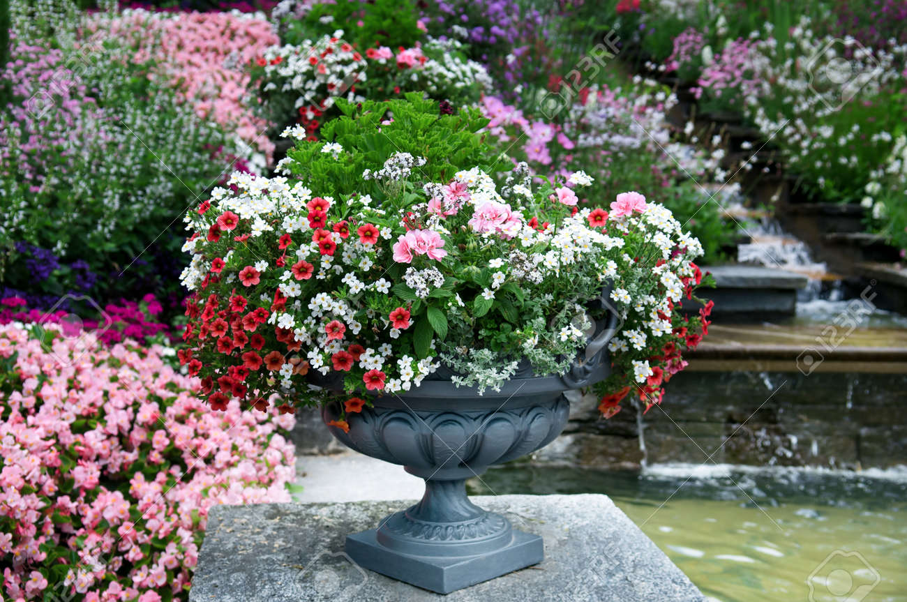 Beautiful Flower Beds And Waterfall Stock Photo