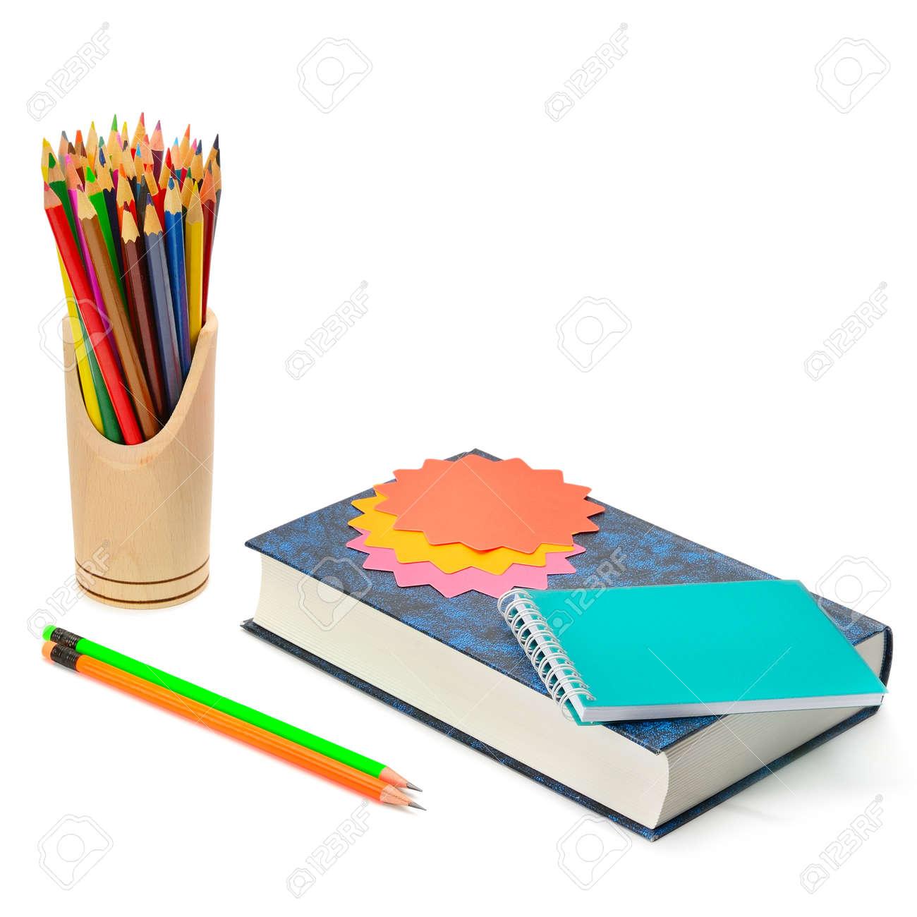Libro, Lápices De Colores Y Pegatinas Aisladas Sobre Fondo Blanco ...
