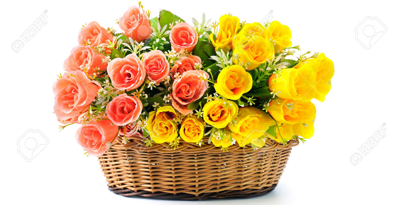 Silk red and yellow flowers in basket isolated on white background silk red and yellow flowers in basket isolated on white background free space for text mightylinksfo