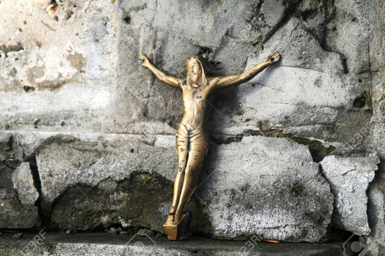 Crucifix Of Jesus On The Cross On The Stone Background Stock Photo