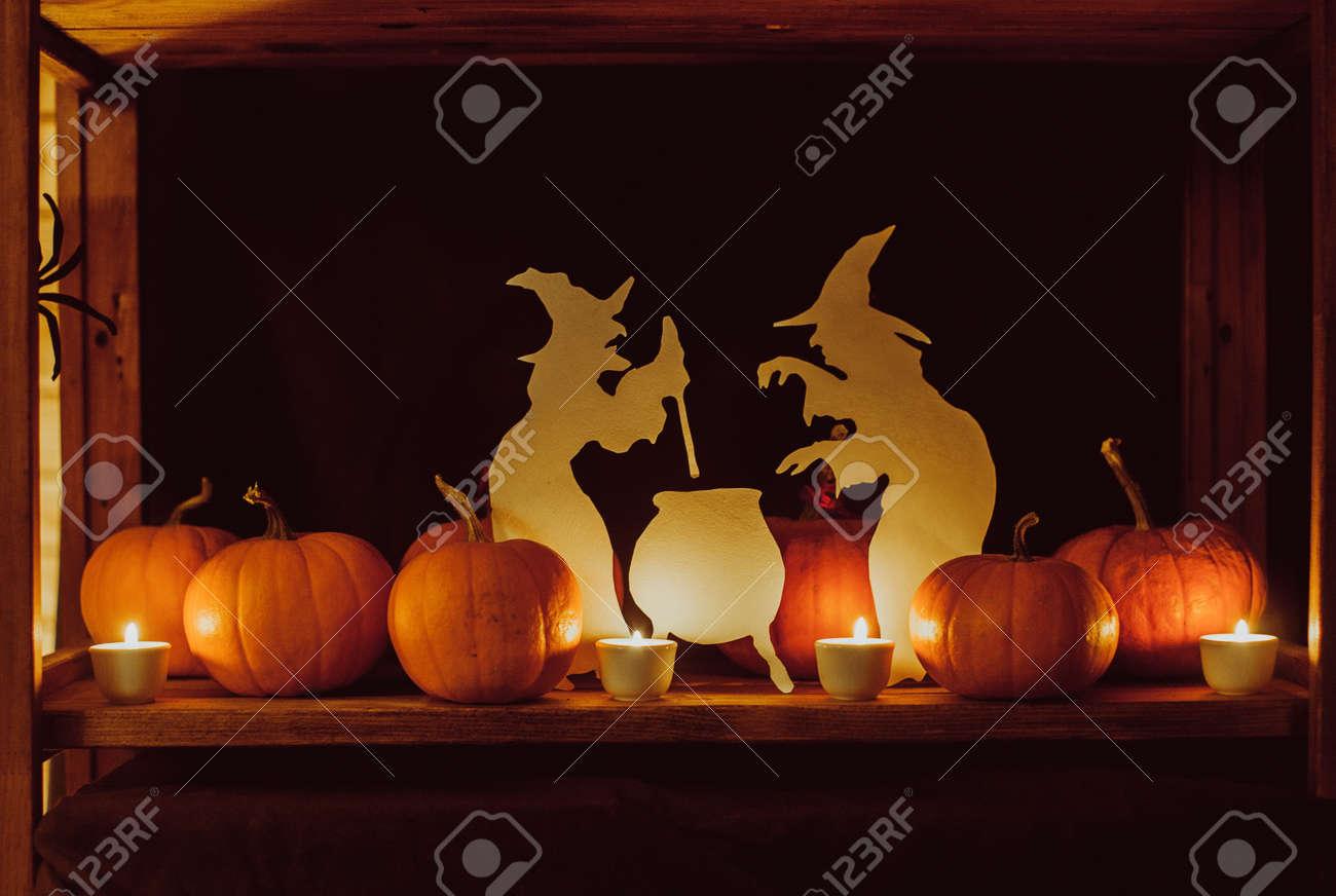 Horizontal photo of Halloween decorations pumpkins candles