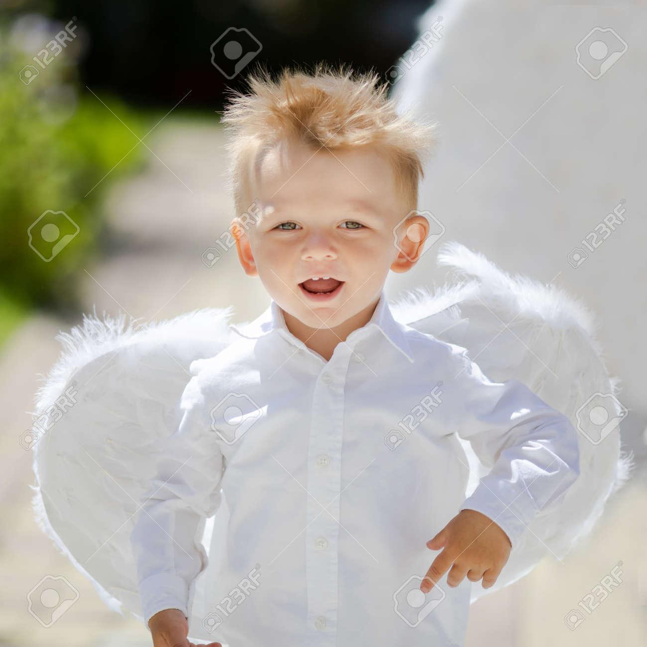 188b447b40f Adorable toddler boy in angel costume, angelic child. Saint Valentines..